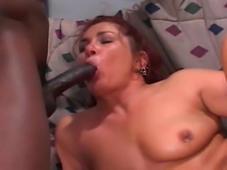 Chubby redhead MILF knows the way to satisfy several men. She gets her holes...