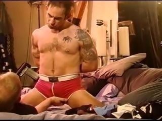 CBT squeezing hairy chested muscled dude's balls through his underwear.