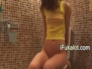 sexy schoolgirl pissing on toilet