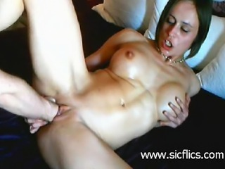 Hot brunette babe with huge silicone tits is brutally double fist fucked in...