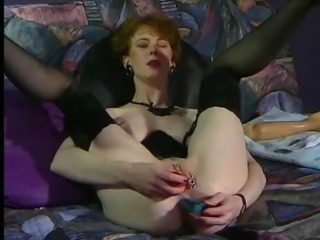 German woman with pierced pussy dildos and fists her ass.