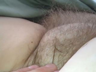 licking her nipple & rubbing her hairy bush.