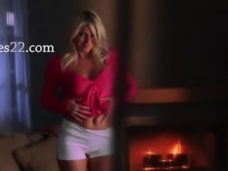 blondie fingering pussy before fireplace