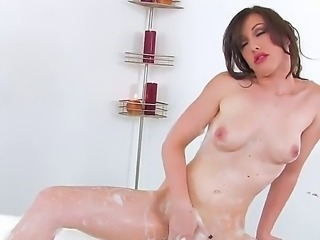 Tiny brunette likes to pet her body and imposing nudity when taking a bubble...