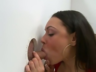 Bethany Benz leans over long white wall and is surprised to see three holes...