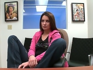 The sympathetic brunette pornstar Candy undresses in front of camera and...
