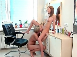 Teen lesbians Inna and Nastie are having fun in their new kitchen and licking...