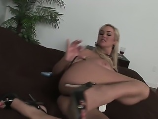 Blonde Abbey Brooks enjoys playing with a really huge dildo over her tight pussy