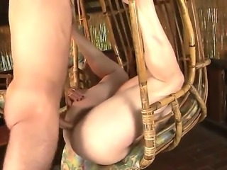 Perverted younger stud is undressing this granny with hairy pussy and...