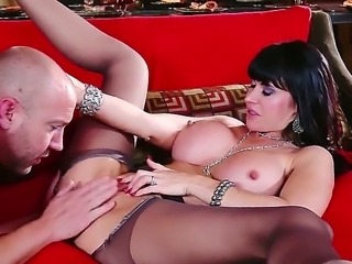 Eva Karera gets in the sexy mood sitting on top of a straight trimmed white...