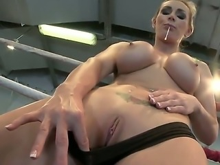 Busty babe Tanya gets so horny and decides to masturbate in a wrestling ring
