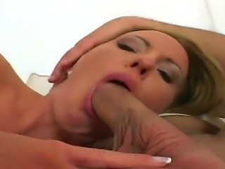 Young red head gal fisting on two large white dicks.