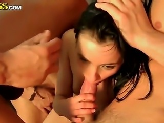 Smoking hot brunette babe Nora enjoys her tight holes banged by two huge...