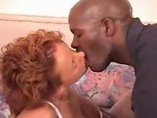 This redhead hottie is into black men. Watch her compilation of kissing...
