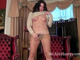 Hairy woman Sharlyn enjoys sitting in her lover's favorite room. She decides...