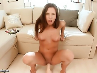 Brunette is full of passion to masturbate with toy