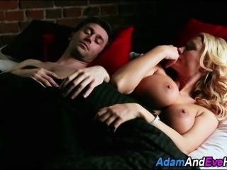 Busty blonde slut sucks cock while stripper dances in stripclub