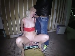 A horny blonde girl cant resist two hard dicks and rides them in an alley....