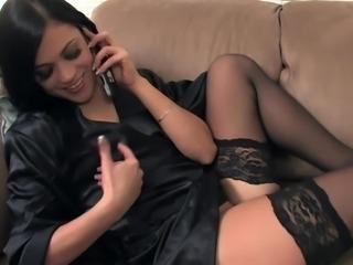 Mandy masturbating on the phone in black nylon
