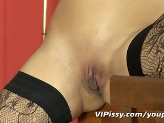 Pissing lesbians in stockings get off with vibrator