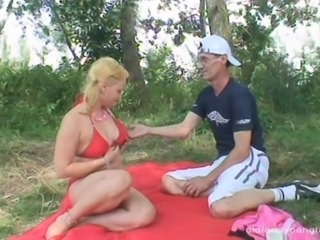 Teen bikini girl is joined on her blanket by a dirty old man