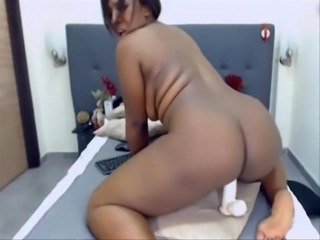 Fat black colombian girl is riding her white dildo