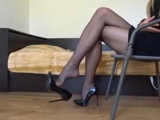 Dangling my black stiletto high heels wearing black stocking