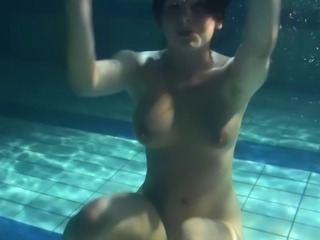 Russian solo model with big tits enjoying cozy pool