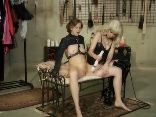 In the sex dungeon the blonde mistress is queen. The slave is there for...