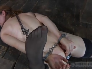 Slave sex hole inserted with toy in femdom BDSM shoot