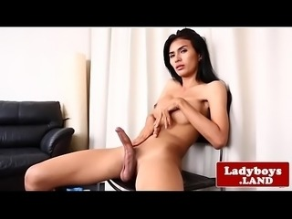 Thai ladyboy tugging herself to climax