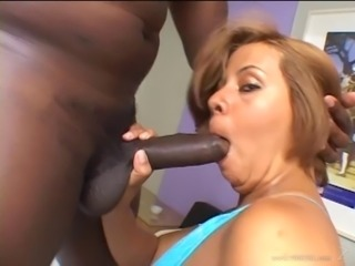 Chubby Brazilian cowgirl with a nice ass giving the big black cock a blowjob...