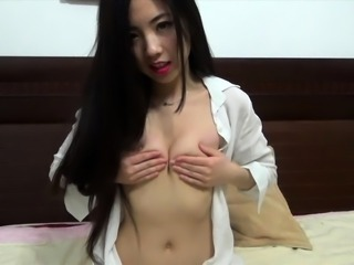 Alluring Oriental camgirl pleases her cunt with her fingers