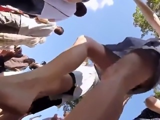 Slender girl with sexy legs and a hot ass upskirt outside