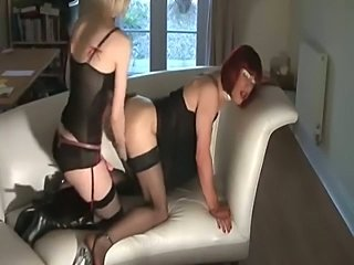Chick with strapon bonks crossdresser on  a couch