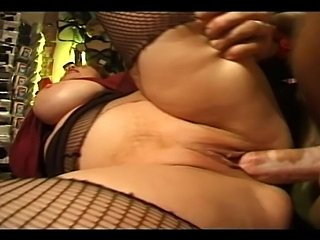 Old redhead bitch seduces a younger guy to fuck her fat holes. She was so...