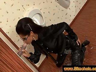 Secretary visits bathroom gloryhole and decides to sucka dick