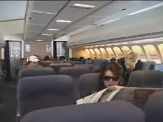 American stewardess gives a asian guy a handjob durningmid flight